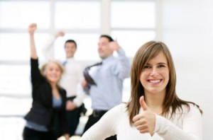 woman thumbs up in front of coworkers